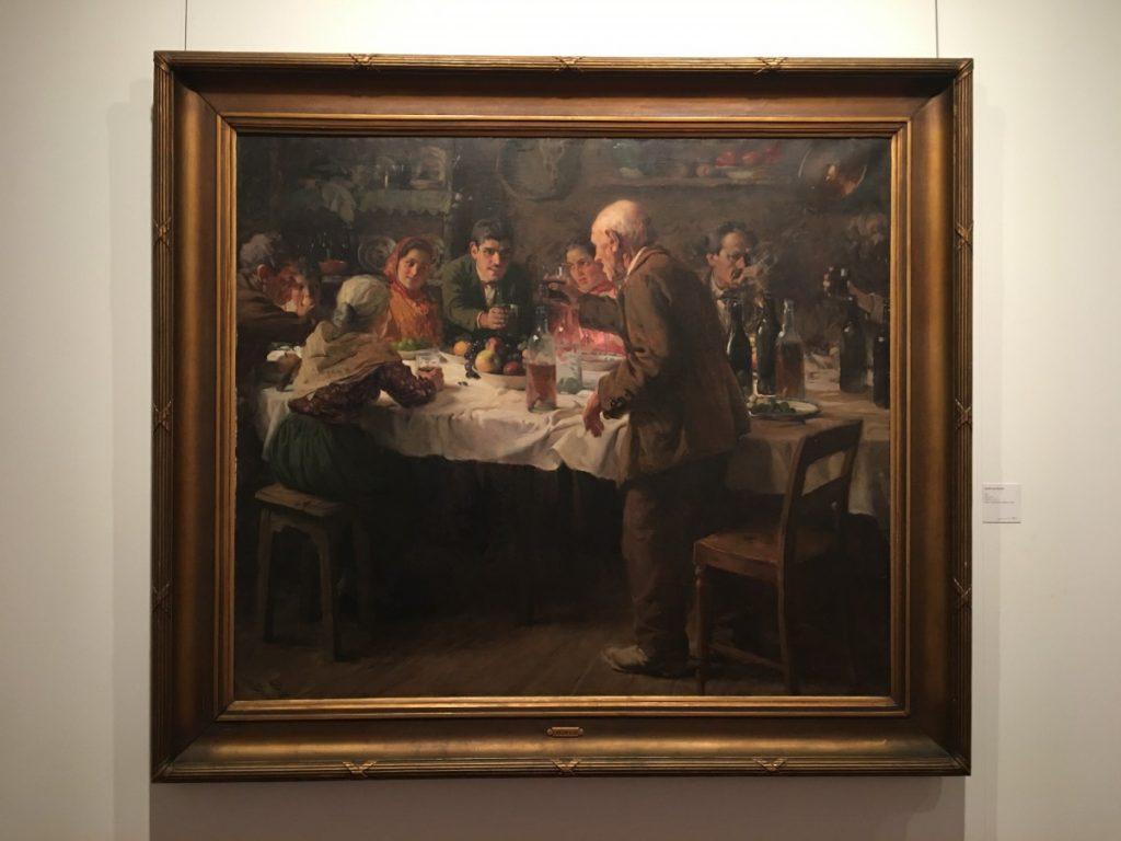 Schilderij van Carlos Reis van een groep mensen aan tafel.
