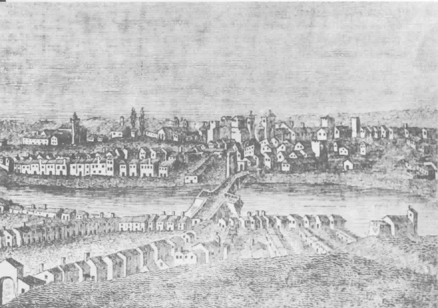 Een gravure uit de 15e-16e eeuw toont Tavira vanuit vogelperspectief. Je ziet de rivier, de brug en aan twee zijden huizen en kerken.