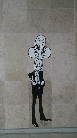 Muurschildering van José Saramago in Lissabon. Hij staat van hoofd tot voeten uitgebeeld, lang en dun met een enorme bril.