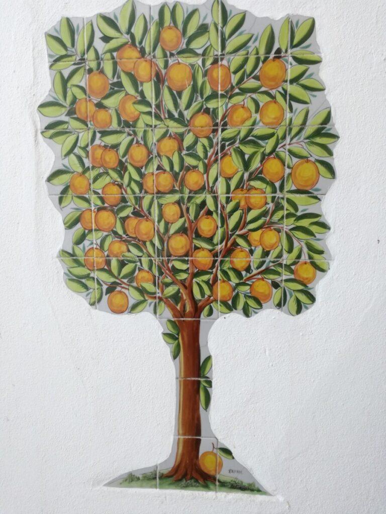 Tegeltableau met sinaasappelboom
